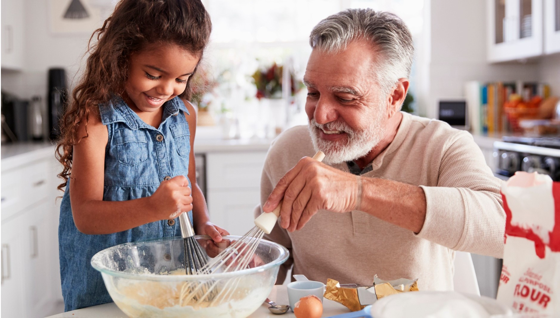 grandfather and granddaughter cooking